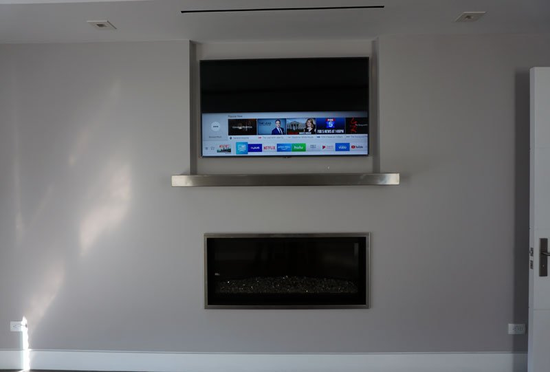 Custom TV Install Mounted Over Fireplace