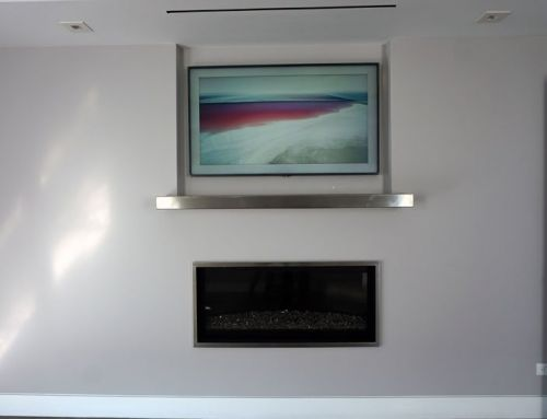 Samsung The Frame TV Mounted Above Fireplace