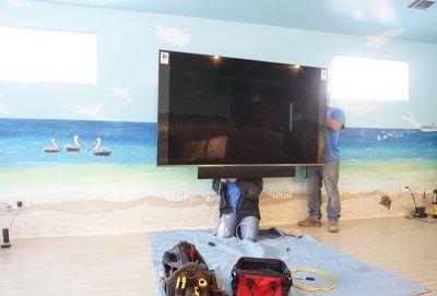"Our team installing a Samsung QN82Q8FNBF - 82"" QLED Smart TV - 4K UltraHD"
