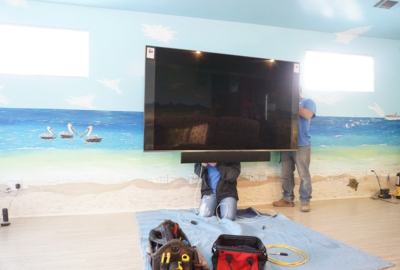 "Our team installing a Samsung QN82Q8FNBF - 82"" QLED Smart TV - 4K UltraHD"