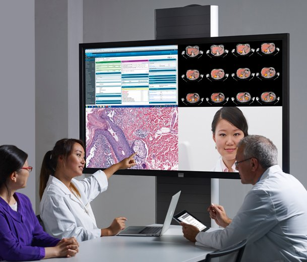 People in a meeting using a wireless presentation