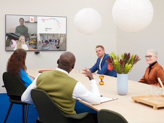 People on a Video Conference call using ClickShare wireless conferencing system